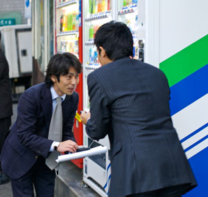 Photo of Two businessmen exchanging Japanese business cards